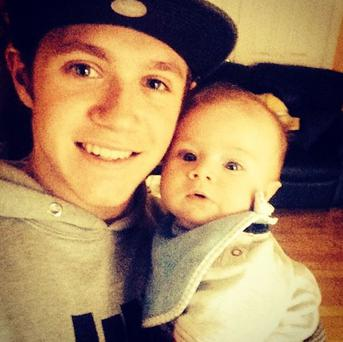 Niall pictured with his nephew Theo, at four weeks old. (Photo: Instagram/Niall Horan)