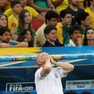 Brazil's coach Luiz Felipe Scolari reacts as his team plays against the Netherlands during their 2014 World Cup third-place playoff at the Brasilia national stadium in Brasilia