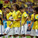 Brazil's David Luiz, center, stands with teammates before a free kick during the World Cup third-place soccer match between Brazil and the Netherlands at the Estadio Nacional in Brasilia