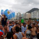 Argentinian fans show their support for their team on Copacabana beach before Sunday's World Cup final match between Argentina and Germany in Rio de Janeiro