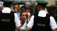 A loyalist supporter challenges PSNI officers after an Orange Order parade