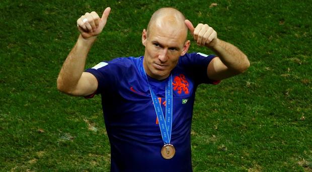 Arjen Robben of the Netherlands acknowledges supporters after winning the 2014 World Cup third-place playoff against Brazil at the Brasilia national stadium