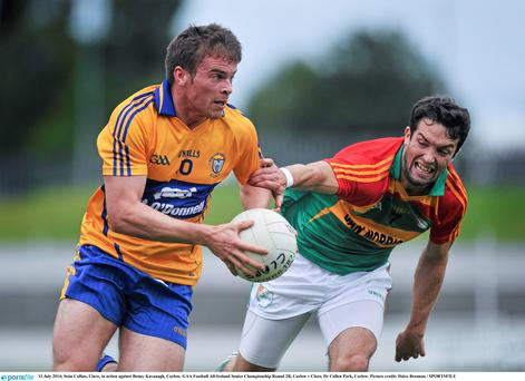 Seán Collins, Clare, in action against Benny Kavanagh, Carlow. GAA Football All-Ireland Senior Championship Round 2B, Carlow v Clare, Dr Cullen Park, Carlow. Picture credit: Dáire Brennan / SPORTSFILE