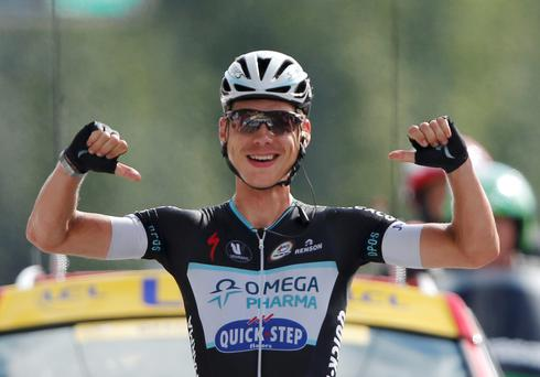 Omega Pharma-Quick Step team rider Tony Martin of Germany celebrates as he crosses the finish line to win the 170-km ninth stage of the Tour de France cycling race between Gerardmer and Mulhouse