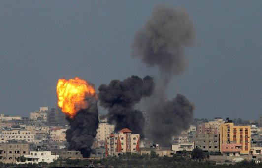 An explosion is seen in the northern Gaza Strip after an Israeli air strike. Reuters