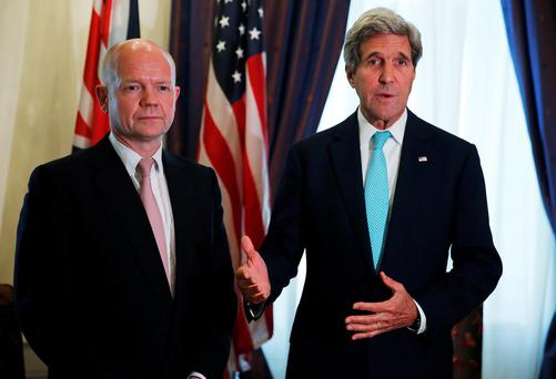 British Foreign Secretary William Hague, left, meets with U.S. Secretary of State John Kerry at talks between the foreign ministers of the six powers negotiating with Tehran on its nuclear program in Vienna, Sunday, July 13, 2014. (AP Photo/Jim Bourg, Pool)