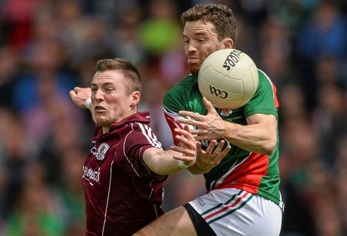 Mayo's Chris Barrett tangles with Danny Cummins of Galway during their Connacht SFC final at MacHale Park in Castlebar. Photo: David Maher / SPORTSFILE