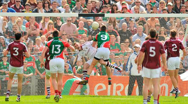 Mayo's Barry Moran scores his side's third goal after getting a touch ahead of Galway 'keeper Manus Breathnach in the Connacht SFC final at MacHale Park. Photo: Ray Ryan / SPORTSFILE