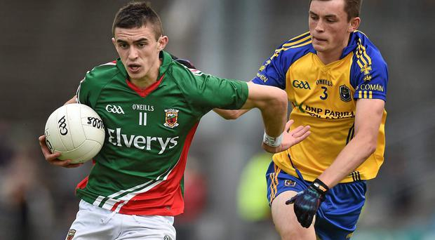 Mayo goalscorer Cian Hanley breaks away from Roscommon's Brian Stack during the Connacht MFC final at MacHale Park this year