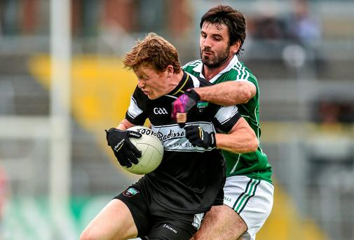 Sligo's Charlie Harrison is challenged by John Galvin of Limerick in their qualifier clash at Markievicz Park. Picture credit: Pat Murphy / SPORTSFILE