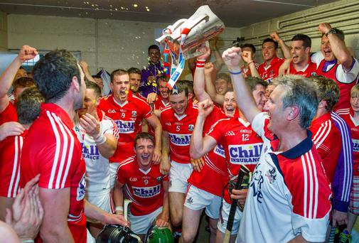 Cork players and officials celebrate in the dressing room after winning the Munster SHC final at Pairc Uí Chaoimh. Photo: Ray McManus / SPORTSFILE
