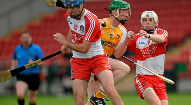 Antrim's Darren Hamill collides with his Derry opponent Liam Og Hinphey during their Ulster SHC final at Owenbeg. Photo: Oliver McVeigh / SPORTSFILE