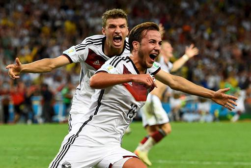 Germany's Mario Goetze celebrates his goal against Argentina infront of teammate Thomas Mueller during extra time. Reuters