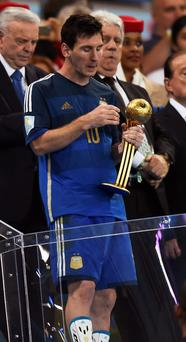 Argentina's Lionel Messi walks down the steps after receiving the Golden Ball for being the best player at the end of the 2014 World Cup final between Germany and Argentina at the Maracana stadium