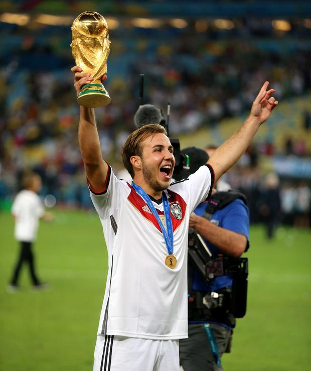 Germany's Mario Gotze celebrate winning the World Cup after the FIFA World Cup Final at the Estadio do Maracana