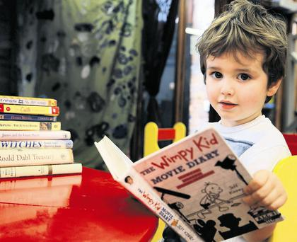 Alfie Murray (8) reads a 'Diary of a Wimpy Kid' book in Louth County Library, Dundalk. Picture: Arthur Carron