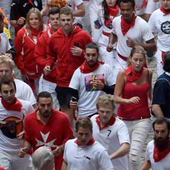 Female runners sprint during the fourth running of the bulls of the San Fermin festival in Pamplona last week. Photo: Reuters