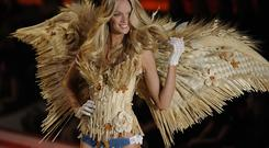 Model Lindsay Ellingson walks on stage during the 2010 Victoria's Secret Fashion Show at the Lexington Armory in New York