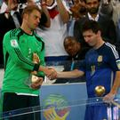 Golden Glove winner Germany's goalkeeper Manuel Neuer (L) congratulates Golden Ball winner Argentina's Lionel Messi (10) after their 2014 World Cup final at the Maracana stadium