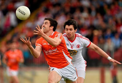 Peter Hughes, Armagh, in action against Brendan Donaghy, Tyrone. GAA Football All-Ireland Senior Championship Round 2B, Tyrone v Armagh, Healy Park, Omagh, Co. Tyrone. Picture credit: Barry Cregg / SPORTSFILE