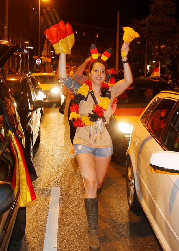 German soccer fans celebrate after the World Cup final between Germany and Argentina in downtown Frankfurt
