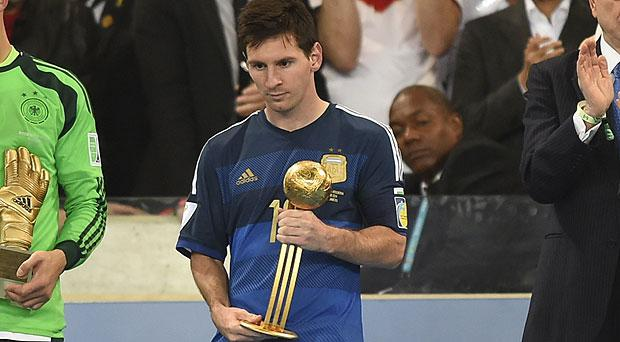 Lionel Messi pictured with the Golden Ball award for player of the tournament at the World Cup