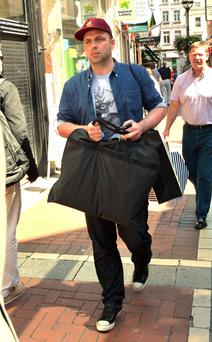 Former Westlife singer Mark Feehily spotted leaving Brown Thomas with shopping bags and getting into a waiting car, Dublin, Ireland - 19.06.13. Pictures: Cathal Burke / VIPIRELAND.COM *** Local Caption *** Mark Feehily