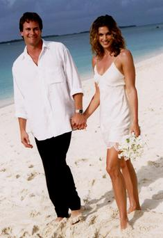 Cindy Crawford and hubby Rande Gerber had a non-traditional beach ceremony in 1998 wearing John Galliano