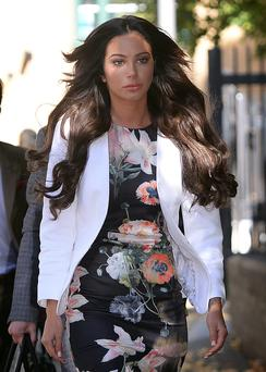 Former X Factor judge Tulisa Contostavlos arrives at Southwark Crown Court in London, where she was due to go on trial accused of being concerned in brokering a drug deal. Stefan Rousseau/PA Wire