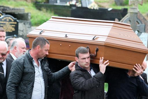 The remains of the late Enda McLaughlin is carried from the Church of the Sacred Heart by family members as his father Patrick walks behind. Credit: North West Newspix