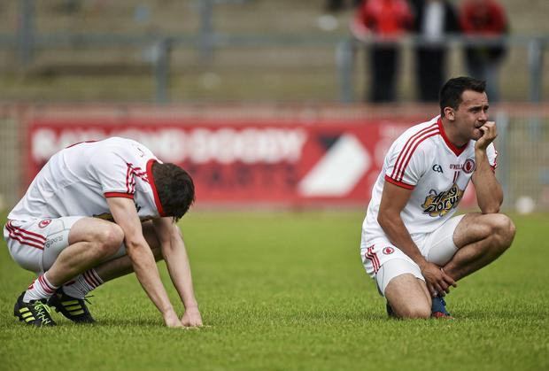 A dejected Colm Cavanagh, left, and Kyle Coney react to Tyrone's defeat to Armagh. Picture credit: Barry Cregg / SPORTSFILE