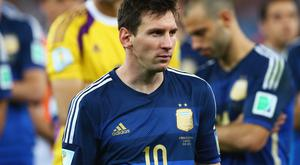 A dejected Lionel Messi looks on after losing to Germany in the 2014 FIFA World Cup Final. Photo credit: Martin Rose/Getty Images