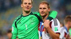 Manuel Neuer and Benedikt Hoewedes, members of Germany's U-21 European Championship-winning team in 2009, celebrate after their victory over Argentina. Photo by Julian Finney/Getty Images