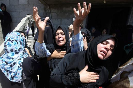 Relatives of three Palestinian members of Abu Muamar family, who hospital officials said were killed in an Israeli air strike on their house, mourn during their funeral in Rafah in the southern Gaza Strip. Reuters