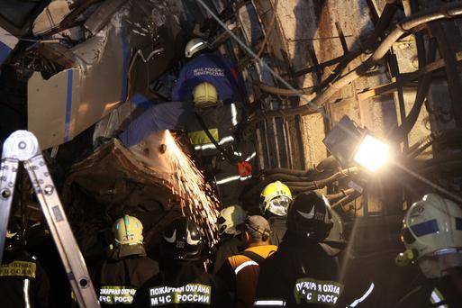 Members of the emergency services work at the site of an accident on the subway in Moscow July 15, 2014. Reuters/Press Service of Russian Emergencies Ministry of Moscow Region/Handout via Reuters