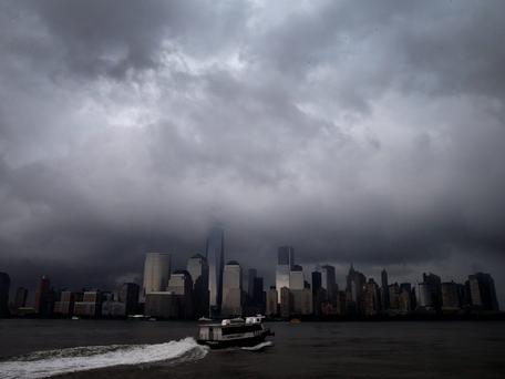 A ferry leaves Jersey City, New Jersey as it heads across the Hudson River towards lower Manhattan and New York City as a heavy thunderstorm passes over the area. According to local reports severe thunderstorm and flash flooding warnings were issued for a second straight day as a powerful series of storms affected much of the northeast U.S. Photo credit: REUTERS/Mike Segar