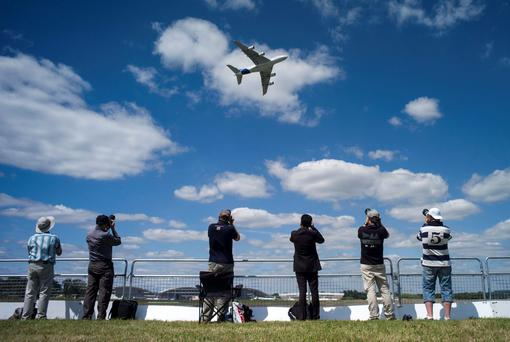 The Airbus Industrie A380 aircraft performs a manoeuvre during its display at the 2014 Farnborough International Airshow in Farnborough
