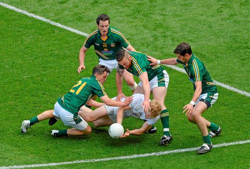 Meath players (L-r) Seamus Kenny, Mickey Newman, Michael Burke and Donal Keogan swarm around Kildare's Tomas O'Connor and they will need to be similarly miserly against Dublin on Sunday Picture credit: Dáire Brennan / SPORTSFILE