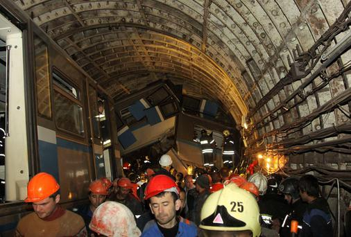 Members of the emergency services work at the site of an accident on the subway in Moscow July 15, 2014.