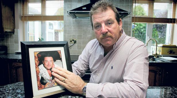 Steve Collins pictured at his home in Limerick in 2009 with a picture of son Roy