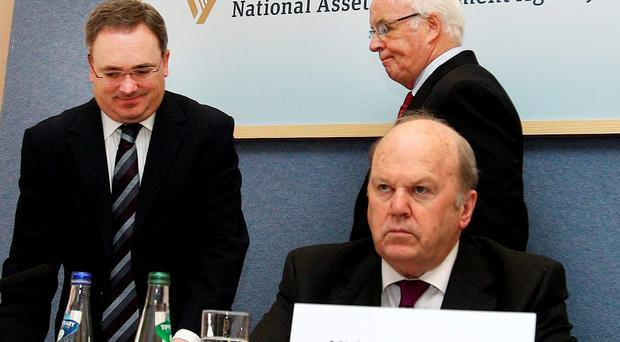 The Minister for Finance Michael Noonan,TD with Frank Daly ( behind Mr.Noonan ) Chairman and Brendan McDonagh, ( left) Chief Executive at the the publication of NAMA's (National Asset Management Agency) Annual Report and Financial Statements for 2013. Pic Tom Burke