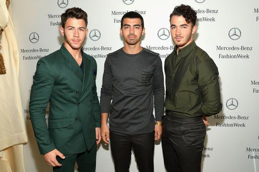 (L-R) Nick Jonas, Joe Jonas, and Kevin Jonas of the Jonas Brothers attend the Mercedes-Benz Star Lounge during Mercedes-Benz Fashion Week Spring 2014, just a few weeks before they announced their sudden split in October 2013