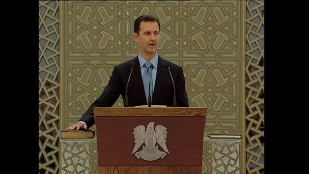 A still image taken from video shows Syria's President Bashar al-Assad speaking as he is sworn in for a new seven-year term at the presidential palace in Damascus July 16, 2014