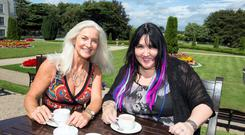 Olivia Treacy having tea with Andrea Smith in the gardens of the Radisson St Helen's Hotel, Stillorgan Rd, Dublin. Pic:Mark Condren 14.7.2014
