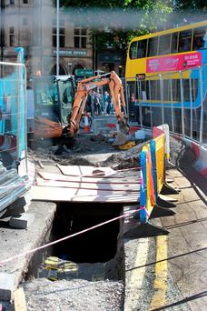 Luas works stop outside Trinity College after the discovery of skeletal remains. Picture: Arthur Carron