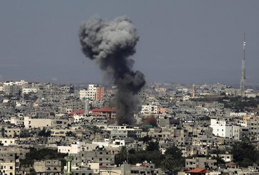 Smoke and flames rise into the sky after an Israeli air attack on Gaza. Photo credit: AP Photo/Adel Hana