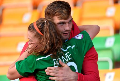 Ireland's Sarah Rowe with Mayo footballer Aidan O'Shea following her side's victory in the UEFA Women's U19 Championship Finals match against Spain. Picture credit: Stephen McCarthy / SPORTSFILE