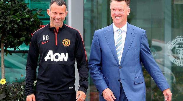 New Manchester United manager Louis van Gaal (right) at the club's training ground yesterday with his assistant manager Ryan Giggs Photo by Matthew Peters/Man Utd via Getty Images