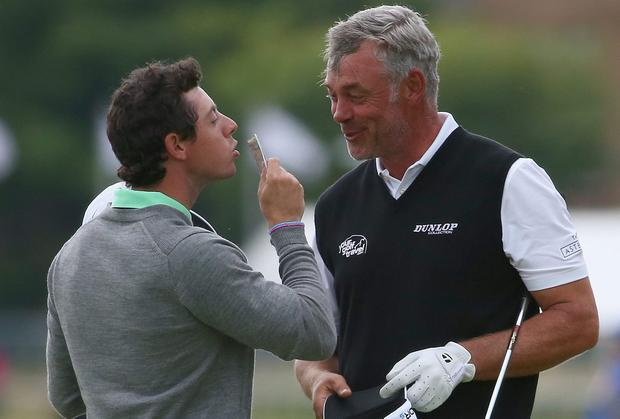 Rory McIlroy kisses a £20 note in celebration of winning a bet against Darren Clarke after their practice round at Hoylake. Photo: Matthew Lewis/Getty Images