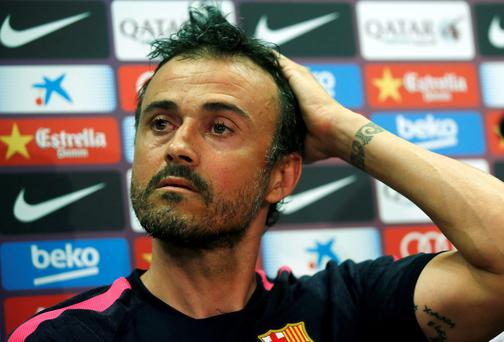 Barcelona coach Luis Enrique reacts during a news conference at the club's training camp yesterday. REUTERS/Albert Gea
